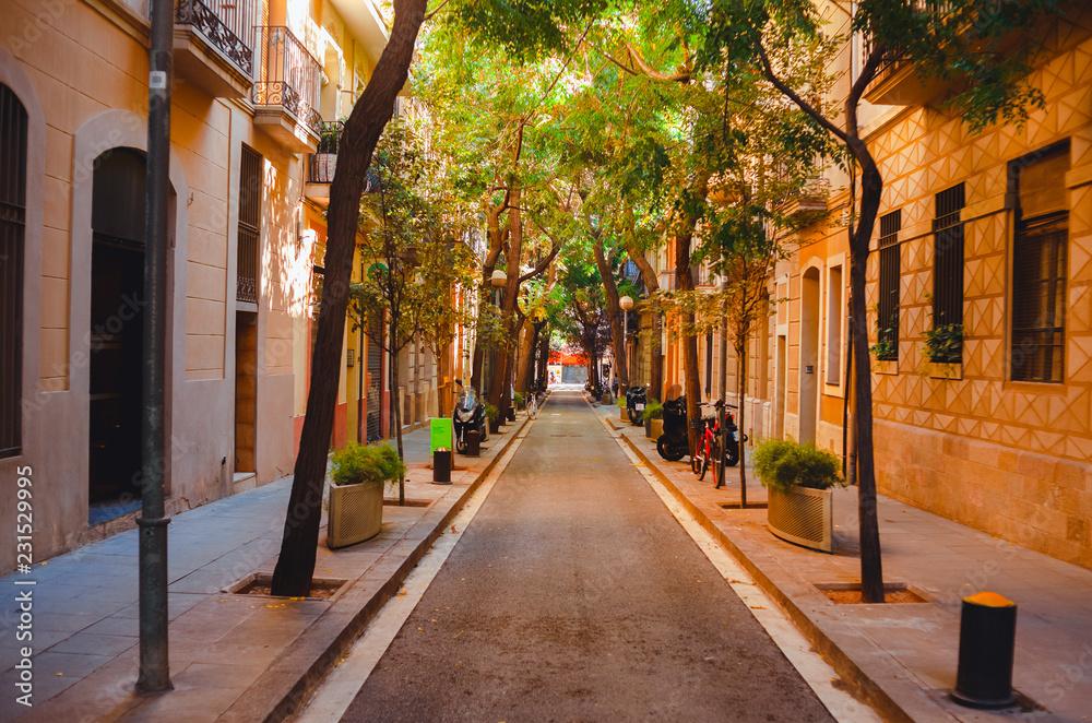The shady street of Barcelona. Spain. September 25, 2018