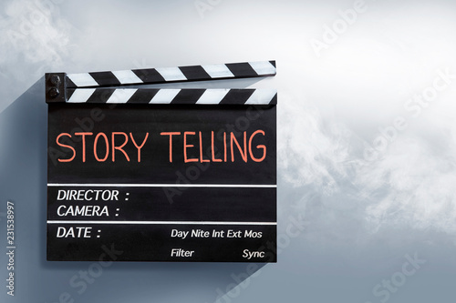Photo  Story telling , red text title on movie Clapper board