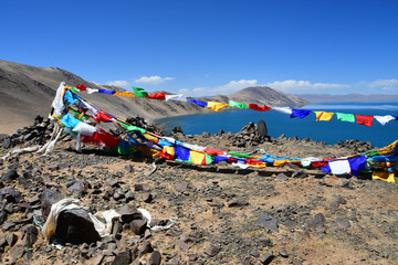 Tibet, Buddhist flags with mantras on Bong Co lake background in summer day
