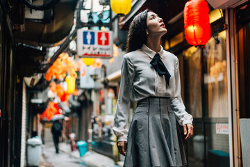 Fototapeta Happy japanese girl walking in Shinjuku, tokyo