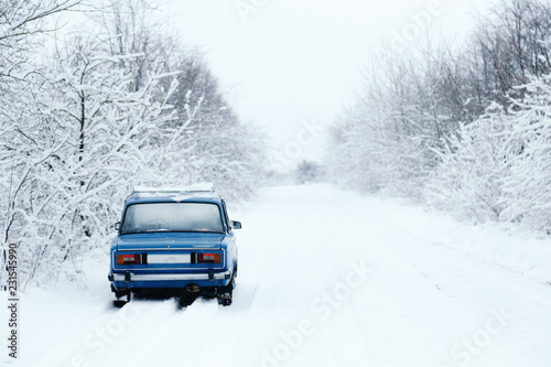 Fotografie, Obraz  blue cars made in the USSR, in the winter forest