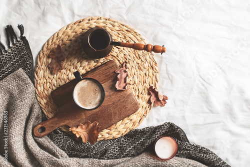cozy hygge autumn and winter coffee flat lay on bed