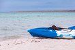 Active rest, sport, kayak. Boat for rafting on water. A few kayaks stand on a sandy beach.