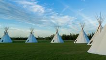 Indigenous Tee Pee On The Prairie At Sunset