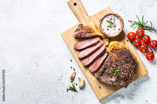 Grilled beef steak ribeye on white. Canvas Print