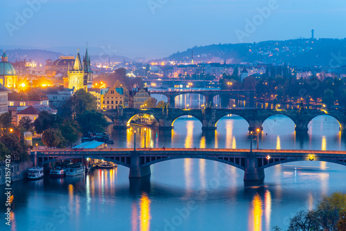 Poster Prague Prague bridges over Vltava River in the evening, Praha, Czech Republic.