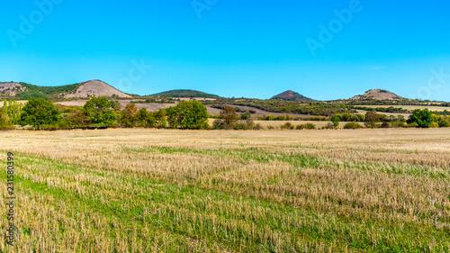 Foto op Plexiglas Blauw Landscape of Ceske Stredohori, aka Central Bohemian Highlands, with typical spiky hills of volcanic origin, Czech Republic.