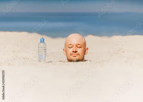 Obraz na plátně Buried till head bald man