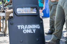 """Armored Shield Used By Police And SWAT With """"training Only"""" Sign On It."""