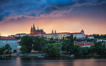 Prague Old Town Including Prague Castle In The Background, One Of The Most Famous Landmarks Of Prague At Sunset With Dramatic Sky.