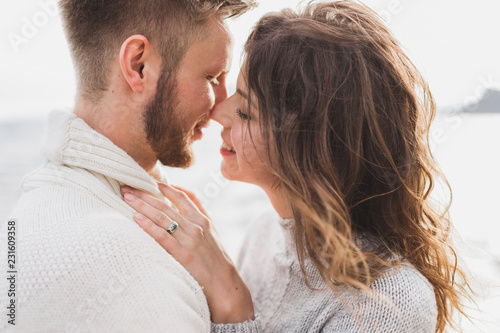 Fotografia  Close-up portrait of man and woman together, happy, looking at each other