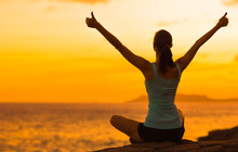 Healthy Woman Celebrating During A Beautiful Sunset. Happy And Free.