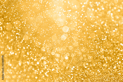 Fototapeta Gold glitter sparkle glam background texture for golden Christmas sparks, weddin
