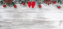 Garlands, Baubles, Snowflakes And Other Holiday Items. Fir Branches And Cones. Xmas Greeting Card. Old Wooden Christmas Background. Top View. Space For Your Text. Horizontally Card.