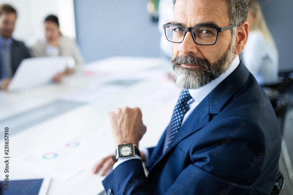 Fototapeta Shot of thinking financial advisor businessman working in office.