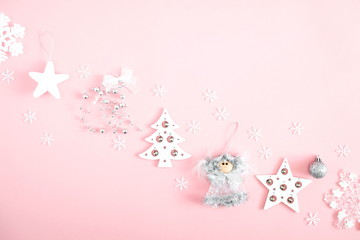 Christmas elegant composition. Xmas silver and white decorations on pastel pink background. Christmas, New Year, winter concept. Flat lay, top view, copy space