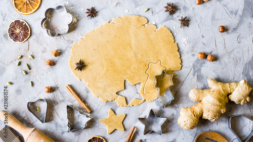 Cooking gingerbread cookies from dough using different forms - heart, star, Christmas tree. Winter home baking. Preparing for christmas concept. Top view