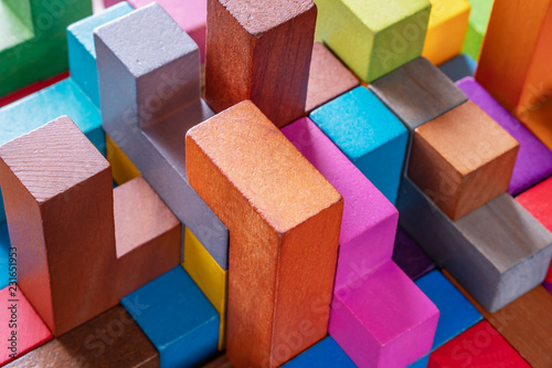 Geometric shapes on a wooden background, close-up. Tableau sur Toile