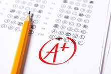 Good Grade Of A Plus (A ) Is Written With  Red Pen On The Tests.