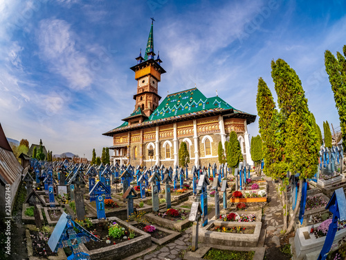 Foto op Canvas Begraafplaats Graveyard in Famous Merry (Joy) Cemetery in Sapanta - Maramures region, Romania.