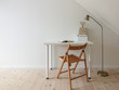 Simple workspace interior. Open book in minimalist home office room. Lamp, books, wooden floor and folding chair. Empty white wall and desk for copy space.
