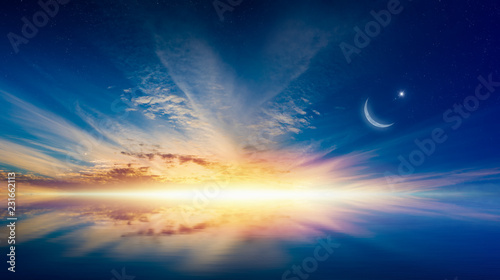 Ramadan Kareem background with crescent, stars and glowing horizon
