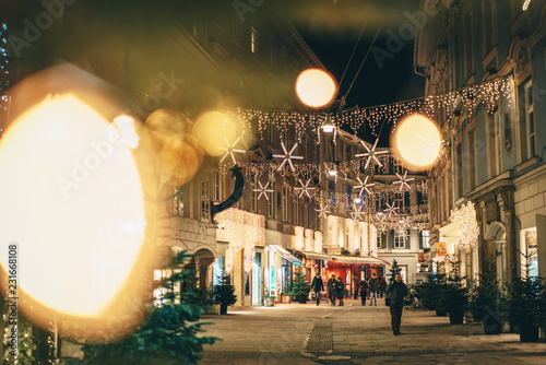 Photo sur Toile Europe Centrale Graz city streets advent Christmas decorations by night. Shot between Christmas lights.