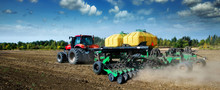 Modern, Green Tractor In The Spring Field Work