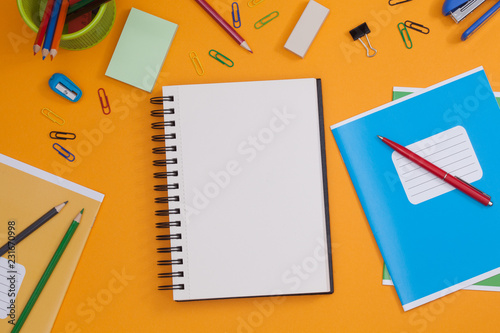 Empty Spiral Notebook With White Page And Multicolored Stationery On