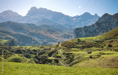 Spoed Foto op Canvas Blauwe jeans Beautiful landscape with path between mountains on a sunny day
