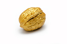 One Golden Walnut On A White Background