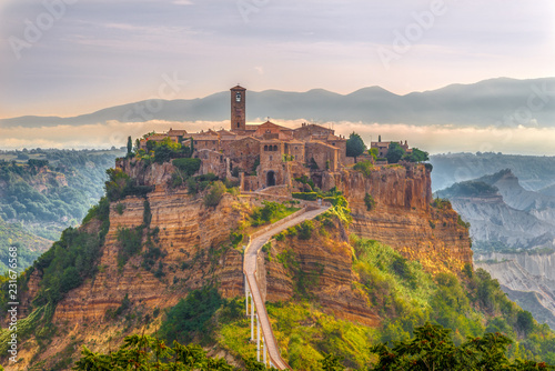 Morning view at the old stone town Civita di Bagnoregio in Italy - 231676568