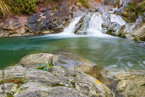 Foto auf Gartenposter Forest river Waterfall and autumn colors. Magic of the Julian pre-Alps.
