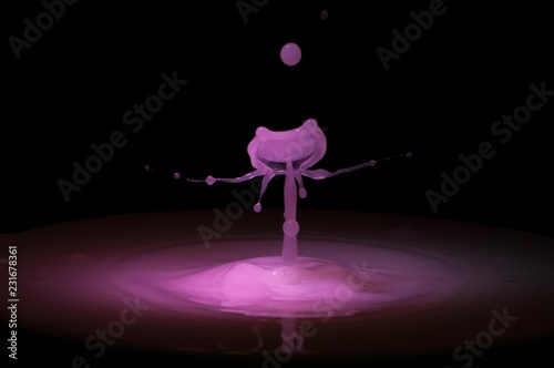 Splash of purple liquid with high speed flash