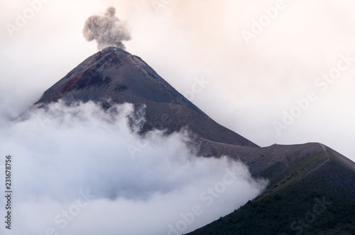 Fotografie, Obraz  Eruption of volcano Fuego in cloudy and misty weather