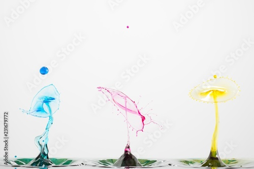 Splash of mixed color liquid with high speed flash