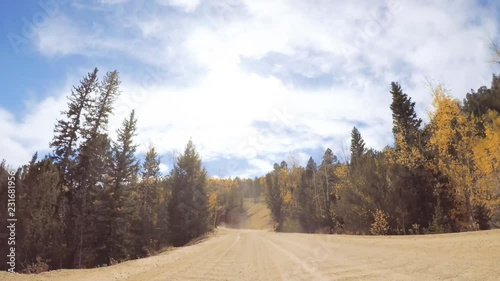 Wall mural - Driving on small mountain dirt roads from Colorado Springs to Cripple Creek in Autumn.