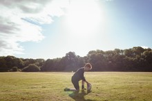 Rugby Player Placing Rugby Ball In The Field