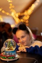 Girl Looking At Christmas Tree Snow Globe