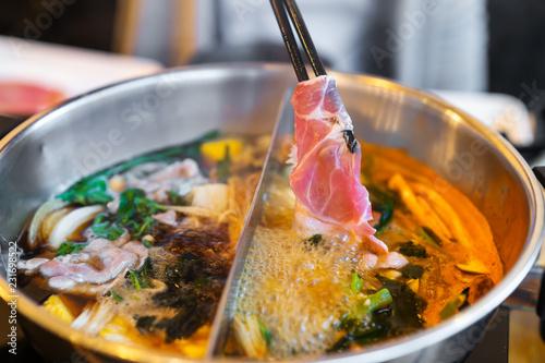 sliced pork meat in shabu or sukiyaki or Japanese hot pot
