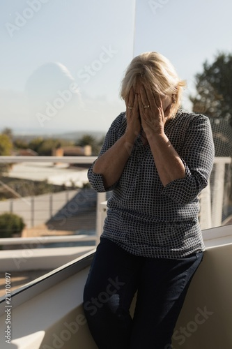 Woman covering her face on terrace