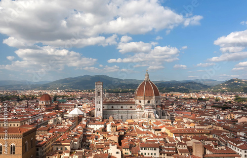 Cityscape with white clouds, narrow streetsm, Duomo and ancient Tuscany houses of Florence, Italy. UNESCO World Heritage Site