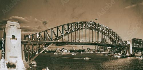Poster Oceanië Night view of Sydney Harbor Bridge from Luna Park Ferris Wheel, Australia