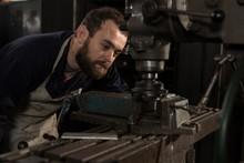 Blacksmith Using Press Drill In Workshop