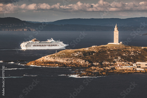 The Tower of Hercules lighthouse and cruise ship entering in th port of A Coruña. Galicia, Spain.