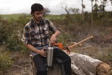 Lumberjack Relaxing On Tree Stump