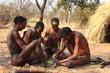 canvas print picture - Buschmänner in Namibia beim Feuer machen