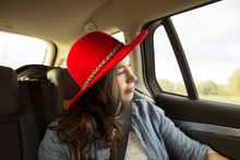 Young Woman Wearing Red Hat Wh...