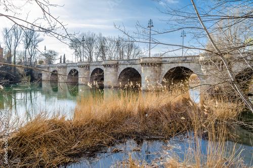 Old stone bridge in the city of Palencia, Spain