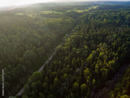 Foto op Canvas Zwart drone image. aerial view of rural area with fields and forests with river and water reflections
